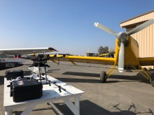 In the Foreground, a Crop-Dusting Drone (UAV) and its bigger brother, the Turbine Thrush in the background at KMIT. (Bruce Holmes)